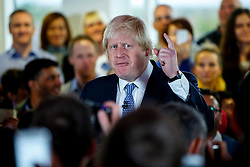 © Licensed to London News Pictures. 05/05/2015. LONDON, UK. Mayor of London Boris Johnson and Conservatives leader and Prime Minister David Cameron speaking to staff at Utility Warehouse in Hendon, northwest London on Tuesday, 5 May 2015. Photo credit : Tolga Akmen/LNP