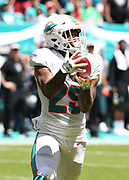 Sep 23, 2018; Miami Gardens, FL, USA; Miami Dolphins cornerback Xavien Howard (25) intercepts a pass from Oakland Raiders quarterback Derek Carr (4) in the first quarter of play at Hard Rock Stadium. The Dolphins defeated the Raiders 28-20. (Steve Jacobson/Image of Sport)