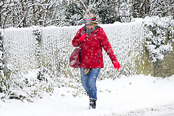 © Licensed to London News Pictures. 10/12/2017. Market Drayton UK. A lady walks through the snow this morning in the village of Market Drayton as Heavy snow begins falling in Shropshire. Photo credit: Andrew McCaren/LNP