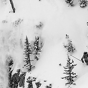 Forrest Jillson releasing new snow off a cliff in the Teton backcountry.