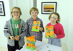 Oscar Walsh with Seamus and Tess Keogh enjoying Culture Night at the Custom House studios Westport.<br />Pic Conor McKeown