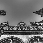 Looking up in Brugge past the crowds reveals some classical Gothic details in many of the buildings of this grand mid-15th century city (Black & White version)