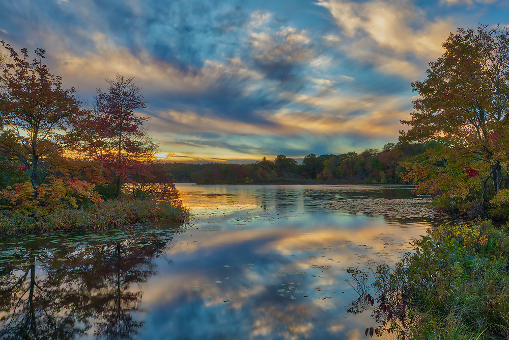 New England fall foliage and sunset photography from Lake Waban in Wellesley, Massachusetts. This Massachusetts lakes is a nearby inspiration and makes for a beautiful New England outdoor location to visit and to also get lost with a camera.<br /> <br /> Wellesley sunset photos are available as museum quality photo, canvas, acrylic, wood or metal prints. Wall art prints may be framed and matted to the individual liking and wall art d&eacute;cor project needs:<br /> <br /> https://juergen-roth.pixels.com/featured/my-guiding-light-juergen-roth.html<br /> <br /> Good light and happy photo making!<br /> <br /> My best,<br /> <br /> Juergen<br /> Photo Prints &amp; Licensing: http://www.rothgalleries.com<br /> Photo Blog: http://whereintheworldisjuergen.blogspot.com<br /> Instagram: https://www.instagram.com/rothgalleries<br /> Twitter: https://twitter.com/naturefineart<br /> Facebook: https://www.facebook.com