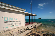 Sign for Chalks Ocean Airlines welcome arrivals along the seaplane landing to Alice Town on the tiny Caribbean island of Bimini, Bahamas. The scene was used in the movie Silence of the Lambs.