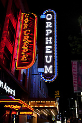 Orpheum and Cafe Crepe signs illumated at night, Granville Street, Vancouver, British Columbia, Canada