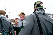 Judge Ken Starr, President and Chancellor of Baylor University, greets the Baylor Bears as they exit the team bus before defeating #9 TCU in Waco, Texas on October 11, 2014. (Cooper Neill for The New York Times)