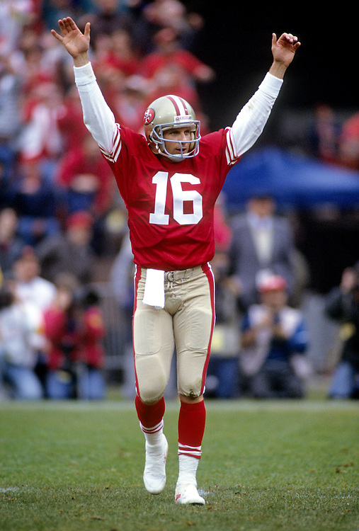 SAN FRANCISCO, CA-UNDATED:  NFL Hall of Fame quarterback Joe Montana signals for a touchdown during a game at Candlestick Park, San Francisco, CA.  Montana played for the San Francisco 49'ers from 1979-1994.  (Photo by Ron Vesely)