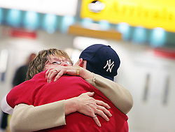 Heathrow Airport, family members greeting each other in arrivals hall, March 2005, Image ref CHE02230d, DP