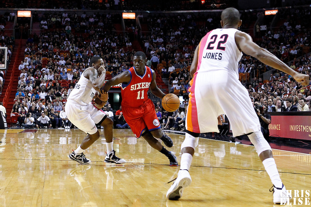 21 January 2012: Philadelphia Sixers point guard Jrue Holidays (11) drives past Miami Heat point guard Mario Chalmers (15) during the Miami Heat 113-92 victory over the Philadelphia Sixers at the AmericanAirlines Arena, Miami, Florida, USA.