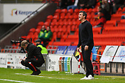 Joey Barton, Manager of Fleetwood Town barks out instructions whilst Grant McCann, Manager of Doncaster Rovers makes notes during the EFL Sky Bet League 1 match between Doncaster Rovers and Fleetwood Town at the Keepmoat Stadium, Doncaster, England on 6 October 2018.