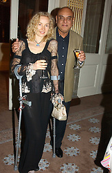 DR M ZACKARIYA and HELENA VESELA at a dinner hosted by Krug champagne at Claridge's, Brooke Street, London on 14th February 2006.<br />