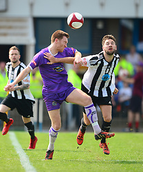 THOMAS HANNIGAN ALTRINCHAM FC BATTLES WITH GRANTHAM JORDAN HEMPENSTALL, Grantham Town v Altrincham Evostik League Premier Division Northern, South Kesteven Stadium, Score 0-2, Altrincham Promoted and Winners of the League Saturday 21st April 2018.