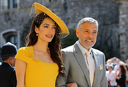 Amal Clooney and George Clooney arrive at St George's Chapel at Windsor Castle for the wedding of Meghan Markle and Prince Harry.