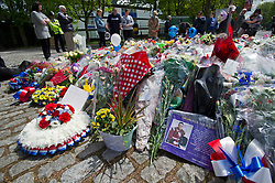 © London News Pictures. 25/05/2013. Woolwich, UK. Flowers and a photo of Drummer Lee Rigby outside Woolwich Barracks in South East London.  Drummer Lee Rigby was murdered by two men in Woolwich town centre in what is being described as a terrorist attack. Photo credit: Ben Cawthra/LNP