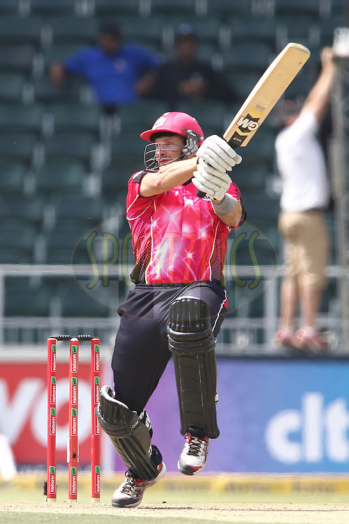 Shane Watson of the Sydney Sixers attacks a delivery during match 3 of the Karbonn Smart CLT20 South Africa between Sydney Sixers and  and Chennai Super Kings held at The Wanderers Stadium in Johannesburg, South Africa on the 14th October 2012..Photo by Shaun Roy/SPORTZPICS/CLT20