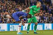 Chelsea forward Tammy Abraham (9) clutches his hand in pain, Valencia goalkeeper Neto (13), during the Champions League match between Chelsea and Valencia CF at Stamford Bridge, London, England on 17 September 2019.
