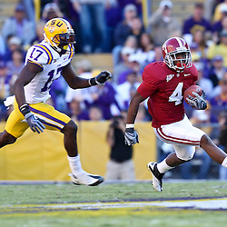 November 6, 2010; Baton Rouge, LA, USA; Alabama Crimson Tide wide receiver Marquis Maze (4) runs away from LSU Tigers cornerback Morris Claiborne (17) during the second half at Tiger Stadium. LSU defeated Alabama 24-21.  Mandatory Credit: Derick E. Hingle