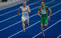 Matic Osovnikar  of Slovenia and Arnaldo Abrantes of Portugal compete in the men's 100m qualifying event of the 2009 IAAF Athletics World Championships on August 15, 2009 in Berlin, Germany. (Photo by Vid Ponikvar / Sportida)