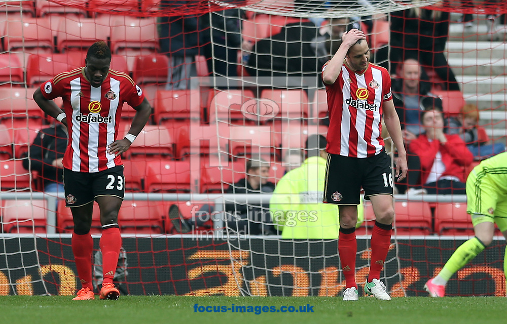 John O'Shea (r) and Lamine Kone (l) of Sunderland react to conceding the opening goal during the Premier League match at the Stadium Of Light, Sunderland<br /> Picture by Simon Moore/Focus Images Ltd 07807 671782<br /> 29/04/2017