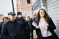 """NAPLES, ITALY - 2 FEBRUARY 2019: Benedetta Cordone (23, right), guide of the bus tour """"Neapolitan Novels"""", is seen here with the bus passengers in the Rione Luzzatti, the neighborhood in which Elena Ferrante's """"My Brilliant Friend"""" is set, in Naples, Italy, on February 2nd 2019.<br /> <br /> In December 2018, City Sightseeing - the world's largest sightseeing tour bus operator - inaugurated the """"Brilliant Naples"""" tour, inspired by the locations in """"Neapolitan Novels"""", a 4-part series by the Italian novelist Elena Ferrante. The series has sold over 10 million copies in 40 countries. The first book in the series has also been adapted into an HBO television series entitled, """"My Brilliant Friend."""""""