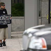 A Ron Paul supporter stands on a busy street during the Republican National Convention in Tampa, Fla. on Wednesday, August 29, 2012. (AP Photo/Alex Menendez)
