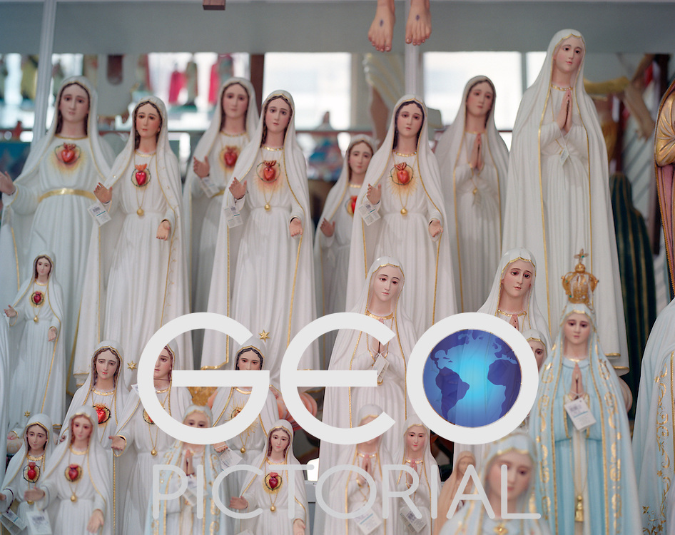 A souvenir shop in Fatima filled with replica statutes of the Madonna of Fatima and other religious statuary.
