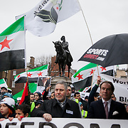 The demonstartion march down Whitehall from Trafalgar Square. An Anti-Assad Syrian demonstration held in Whitehall, Central London. The demonstration was called by the Syrian Community in the UK under the head lines; Syrians are being killed in a genocide and the world is watching. Several hundreds gathered opposite Downing Street 10 calling for Syrians to unite and the world to intervene.