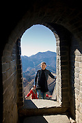 Tourists at a Great Wall of China watchtower at Mutianyu, north of Beijing (formerly Peking), China