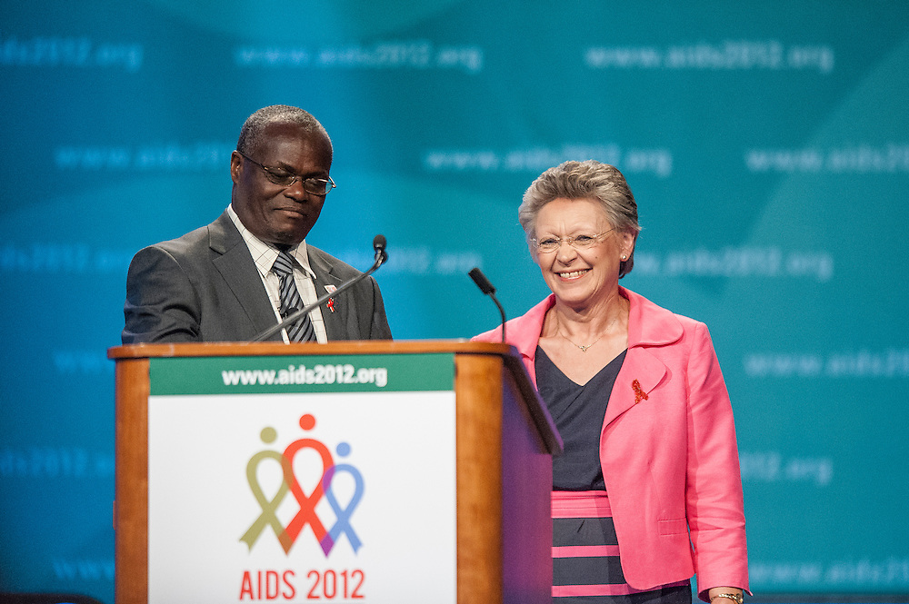 Outgoing IAS President Dr. Elly Katabira introduces incoming president Françoise Barré-Sinoussi during the closing ceremony of the 2012 International AIDS Conference in Washington, D.C.