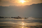 Morning commute on Lake Inle.  Sitting in one of the typical slender wooden canoes you are very close to the water and have a great sense of perspective over the lake (albeit with the occasional fisherman or taxi buzzing past)