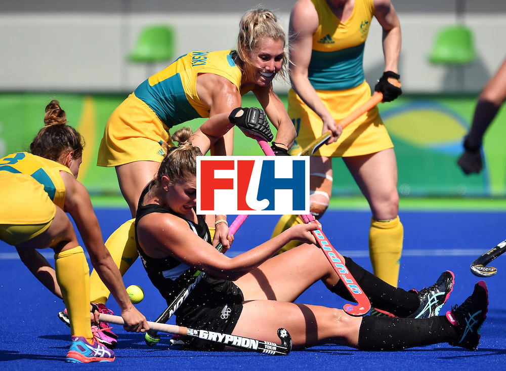 New Zealand's Olivia Merry (bottom) vies with Australia's Casey Sablowski (top) during the the women's quarterfinal field hockey New Zealand vs Australia match of the Rio 2016 Olympics Games at the Olympic Hockey Centre in Rio de Janeiro on August 15, 2016. / AFP / Pascal GUYOT        (Photo credit should read PASCAL GUYOT/AFP/Getty Images)