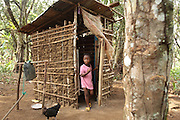 A girl comes out of a home latrine in the village of Kawejah, Grand Cape Mount county, Liberia on Friday April 6, 2012. As part of the UNICEF sponsored CLTS programme, communities learn to put in practice good hygiene and sanitation practices.