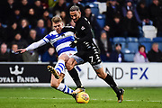QPR defender Jake Bidwell (3) tackles Leeds United striker Kemar Roofe (7) during the EFL Sky Bet Championship match between Queens Park Rangers and Leeds United at the Loftus Road Stadium, London, England on 9 December 2017. Photo by Dennis Goodwin.