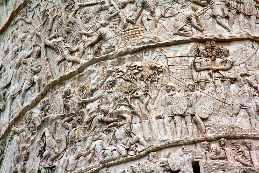 Trajan's Column is a Roman column commemorating the Roman Emperor Trajan's victory in the Dacian Wars. Located in Trajan's Forum, north of the Roman Forum. The spiral Bas Relief artistically describes the epic battles between the Romans and Dacians. Completed in 113 AD. Rome. Italy 2013