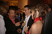 HAMISH MCALPINE and carole siller. HAMISH MCALPINE, Champagne reception celebrating 100 years of Chinese cinema  hosted by Hamish McAlpine of Tartan Films, Raising money for Care For Children, a foster care programme in China. Aspreys. New Bond St. London. 25 April 2006. ONE TIME USE ONLY - DO NOT ARCHIVE  © Copyright Photograph by Dafydd Jones 66 Stockwell Park Rd. London SW9 0DA Tel 020 7733 0108 www.dafjones.com