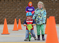 Kasen Catlin (from left) receives some help from his sister, Karmindy Catlin, 5, both of Cedar Rapids, as he makes his way through the RAGBRAI themed course during the 2nd Annual Bike Rodeo at Kaplan University, 3165 Edgewood Parkway, in Cedar Rapids on Saturday morning, April 28, 2012. Activities included a safety talk from the Cedar Rapids Fire Department and Cedar Rapids Police Department, bike adjustments, a bike helmet giveaway, RAGBRAI themed course, and bike giveaway drawing. (Stephen Mally/Freelance)
