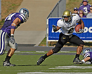 Colorado running back Hugh Charles (2) rushes up field against Kansas State's Blake Seiler (L) in the first half at KSU Stadium in Manhattan, Kansas, October 29, 2005.  The Buffaloes beat K-State 23-20.