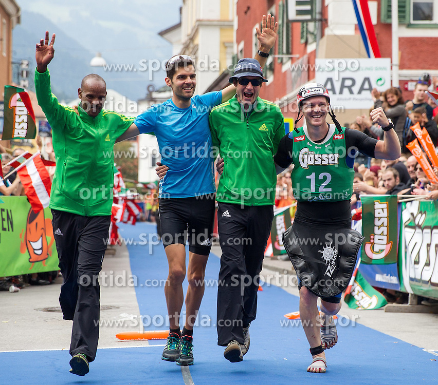 07.09.2014, Hauptplatz, Lienz, AUT, Red Bull Dolomitenmann 2014, Ziel im Bild Siegerteam Team ADIDAS OUTDOOR v.l. Bergläufer Abraham Kidane Habtom (ERI), Mountainbiker Lukas Buchli (SUI), Paragleiter Jakob Herrmann (AUT), Kajaker Stephan Brodicky (AUT) // at the finish Area during the 2014 Red Bull Dolomitenmann at the Hauptplatz in Lienz, Austria on 2014/09/06, EXPA Pictures © 2014, PhotoCredit: EXPA/ Johann Groder