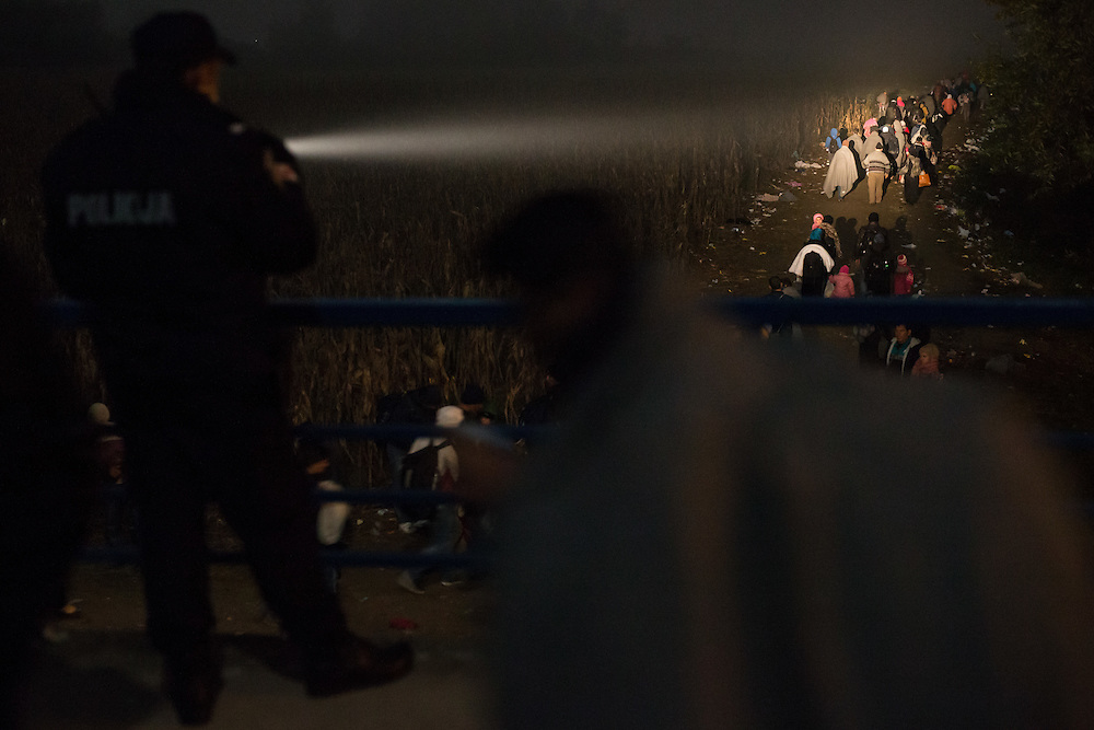 26.10.2015, refugees crossing border over the bridge between Slovenia in Croatia and walking through no man's land to the open air center on the fields where they must wait for the room in the reception centers in Rigonce, Dobova and Brezice.