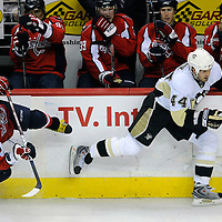 08 March 2009:  Washington Capitals left wing Alex Ovechkin of Russia tries to keep his feet after being hit by Pittsburgh Penguins defenseman Brooks Orpik (44) in overtime at the Verizon Center in Washington, D.C.  The Penguins defeated the Capitals 4-3 in a shootout to send the Capitals to their fourth consecutive defeat.