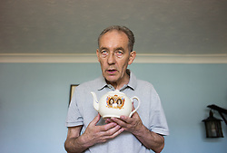 © Licensed to London News Pictures. 09/04/2014<br /> <br /> Durham, United Kingdom<br /> <br /> Parkinson's Disease sufferer David Forsyth from Brandon, County Durham holds one of the many items in his royal porcelain collection that he has collected for many years. <br /> <br /> Parkinson's is a long-term neurological condition that affects the way the brain co-ordinates body movements including walking, talking and writing and affects both men and women.<br /> <br /> Photo credit : Ian Forsyth/LNP