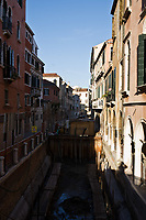 along small canal in the beautiful city of venice in italy