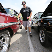 Kevin Guntor of Zion Illinois wipes down his '64 Ford Galaxie 500 Friday morning as the annual Blue Suede Cruise gets underway at the BancorpSouth Arena in Tupelo.