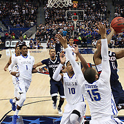 Ryan Boatright, UConn, shoots past Marquel Curtis, Tulsa, during the UConn Huskies Vs Tulsa Semi Final game at the American Athletic Conference Men's College Basketball Championships 2015 at the XL Center, Hartford, Connecticut, USA. 14th March 2015. Photo Tim Clayton