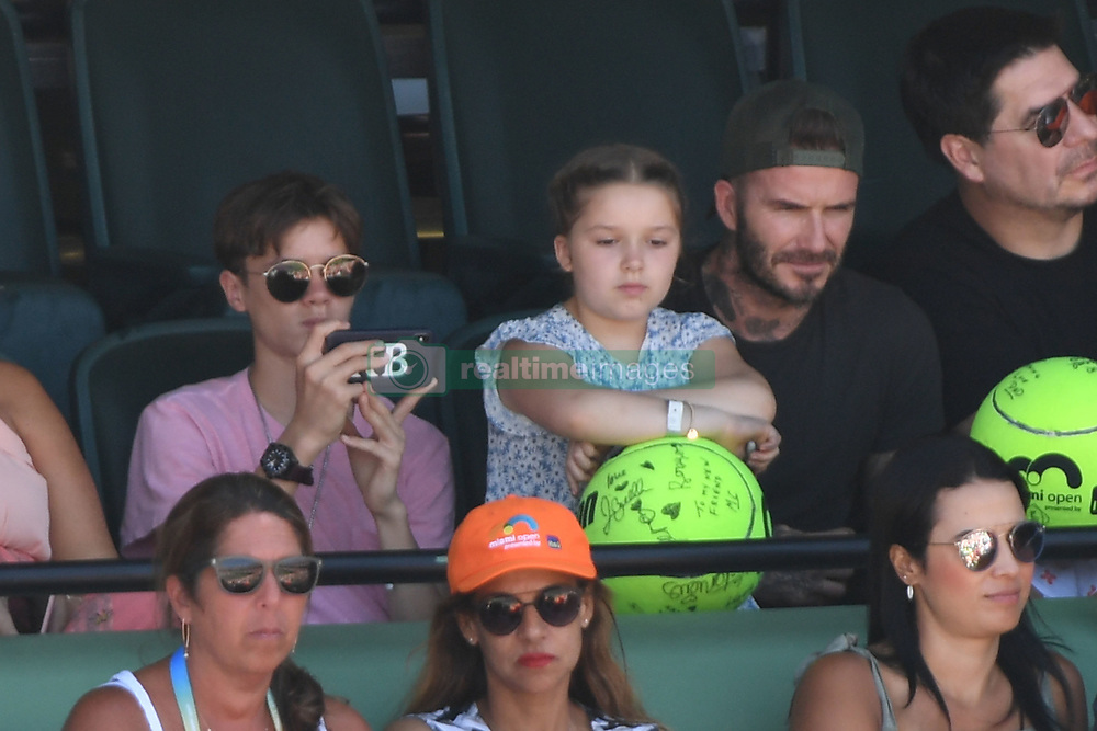 KEY BISCAYNE, FL - APRIL 01 : Victoria Beckham and David Beckham seen watching John Isner Vs Alexander Zverev during the mens final during the 2018 Miami Open at Crandon Park Tennis Center on April 1, 2018 in Key Biscayne, Florida. CAP/MPI04 ©MPI04/Capital Pictures. 01 Apr 2018 Pictured: Romeo Beckham, Harper Beckham, David Beckham. Photo credit: MPI04/Capital Pictures / MEGA TheMegaAgency.com +1 888 505 6342