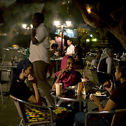 Sudanese teenagers hang out at Ozone cafe, Khartoum's trendiest night spot. Outdoor air conditioning mists through the air to cool clients  from Khartoum's oppressive heat. Sudan is experiencing an economic boom, and investors mainly from the Gulf countries and China, are flocking to Africa's largest country.