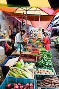 Fresh vegetable vendors in Palau Tikus market.