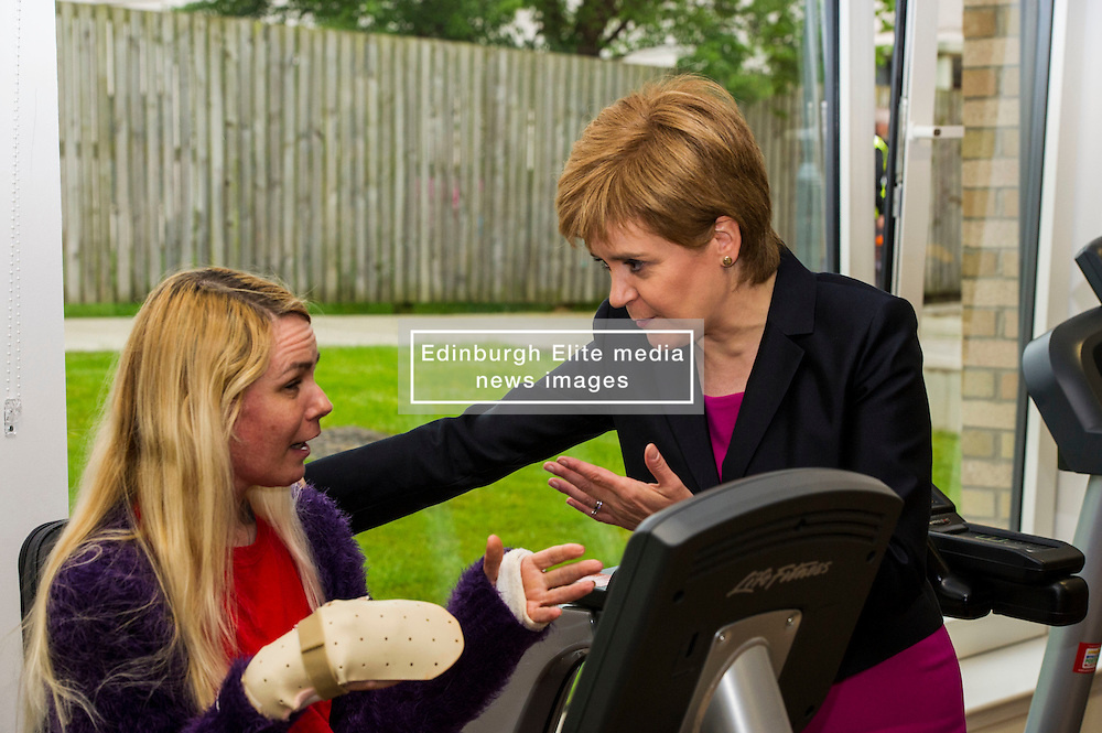 Pictured: Nicola Sturgeon met an old school friend, Lorraine Hill, who was at the same primary and secondary school<br /> <br /> The First Minister Nicola Sturgeon, MSP, joined people supported by the Thistle Foundation to bury a time capsule to mark the opening of a new health and social care centre. <br /> Ger Harley   EEm 14 June 2016