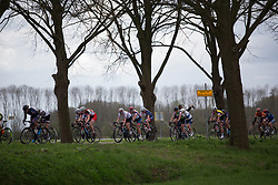 The peloton is strung out by constant attacks in the third lap during Stage 4 of the Healthy Ageing Tour - a 126.6 km road race, starting and finishing in Finsterwolde on April 8, 2017, in Groeningen, Netherlands.