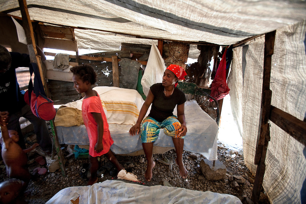 Venise Germain, 10-year-old girl, and her mom Isema Germain. Venise was raped in the last 3 months in the makeshift refugee camp, La Piste, in Port-au-Prince, Haiti on July 20, 2010. La Piste (French for &quot;runway&quot;)is a settlement sprawled across the site of a disused airport and now home to an estimated 20,000 earthquake survivors living in makeshift structures.<br /> Six month after a catastrophic earthquake measuring 7.3 on the Richter scale hit Haiti on January 13, 2010, killing an estimated 230,000 people, injuring an estimated 300,000 and making homeless an estimated 1,000,000.
